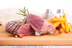 Beefsteak and french fries Stock Images