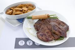 Beefsteak with a fried potato stock photography