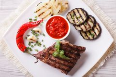 Beefsteak, grilled vegetables and sauce horizontal top view Stock Photo