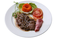Beefsteak with ham Royalty Free Stock Images
