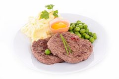 Beefsteak, mashed potatoes and pea royalty free stock photography
