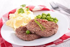 Beefsteak, mashed potatoes and pea stock images