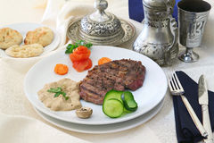 Beefsteak ottoman. Beefsteak serving on white plate in turkish restaurant Stock Photos