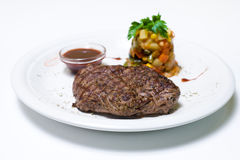 Beefsteak with salad. And sauce Royalty Free Stock Image