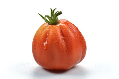 Beefsteak Tomato with Drops 4. One Beefsteak Tomato with Drops on white board Stock Photos
