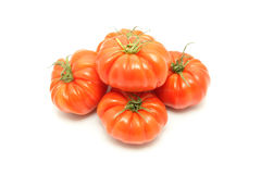 Beefsteak tomatoes. Details of beefsteak tomatoes on white stock images