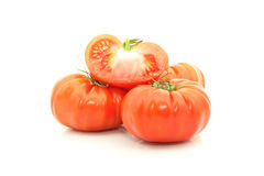 Beefsteak tomatoes. Details of cross section of beefsteak tomatoes on white stock images