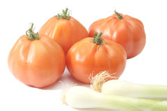 Beefsteak tomatoes and spring onions Royalty Free Stock Photo