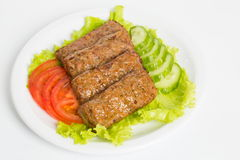 Beefsteak in a white plate Stock Images