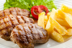 Beefsteaks and French fries Royalty Free Stock Images