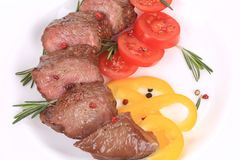 Beefsteaks with tomatoes and rosemary. Stock Image