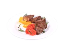 Beefsteaks with tomatoes and rosemary. Stock Photo