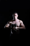 Beefy guy with a dumbbell Royalty Free Stock Images