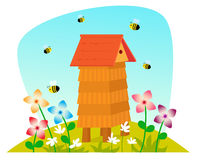 Beehive. Cute cartoon beehive on a field with flowers and bees Royalty Free Stock Photo