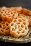 Beehive Fritters kueh ros. Beehive Fritters or Honeycomb Cookies or kueh rose on rattan tray stock image