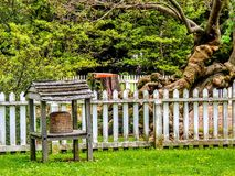 Beehive in front of White Picket Fence and ancient tree Stock Images