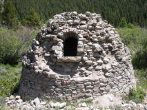 Beehive kiln used to make charcoal for silver smelting circa 1930 Royalty Free Stock Photos