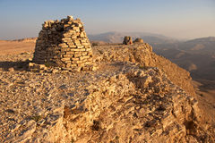 Beehive Tombs of Bat. Lined up dramatically atop a rocky ridge, the Beehive Tombs of Bat, in Oman, are among the most unique ensemble of 4000-5000 year-old stock photos