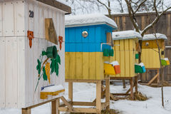 Beehives in the apiary in winter Royalty Free Stock Image