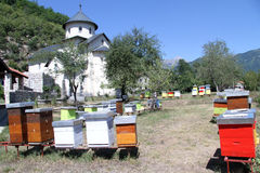 Beehives and church Stock Image