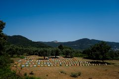 Beehives at Thasos. Near a hiking trail. Bee boxes are placeed in a perfectly shape stock image