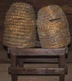 Beehives. Two beehives from the 19th century made of straw stock photo