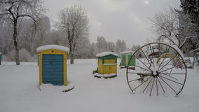 Beehives in winter and vintage horse rake agriculture tool, time lapse 4K stock footage