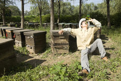 Beekeeper and beer Royalty Free Stock Photo