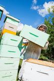 Beekeeper Carrying Honeycomb Crate Stock Image