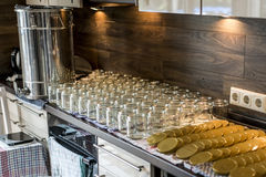 Beekeeper filling up the fresh golden new honey into glass jars Stock Photo