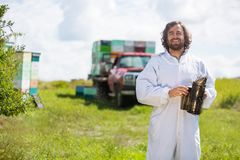 Beekeeper In Holding Smoker At Apiary Stock Photo