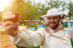 Beekeeper removes itself on the apiary Action Camera. Video Blog Royalty Free Stock Image