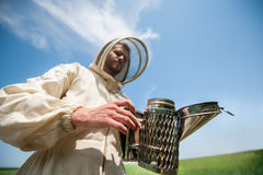 Beekeeper with smoke tool Royalty Free Stock Image