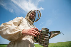 Beekeeper with smoke tool Stock Photos