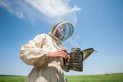 Beekeeper with smoke tool Stock Image