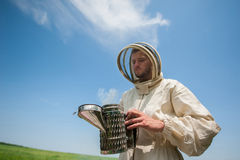 Beekeeper with smoke tool Stock Photo