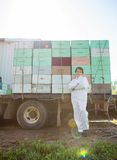 Beekeeper Standing Against Truck Loaded With Stock Images