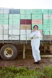 Beekeeper Standing Against Truck Loaded With royalty free stock photo