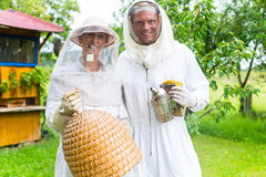 Beekeeper team working outdoor with smoker Stock Photography