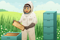 Beekeepers with honey comb Royalty Free Stock Photos