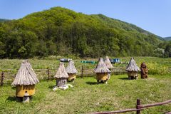 Picturesque beehives, similar to the houses. stock photography