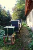 Beekeeping honey farm. Beekeeping boxes at the back of a barn royalty free stock photos