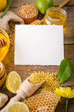 Beekeeping products with lemons on a wooden table. With empty card for you text . side view stock photos