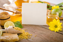 Beekeeping products on a wooden table with card for your text Royalty Free Stock Photo