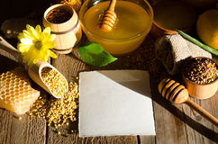 Beekeeping products on a wooden table with empty card for text. Beekeeping products on a wooden table with empty card for you text . side view royalty free stock image