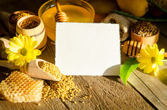Beekeeping products on a wooden table with empty card for text. Beekeeping products on a wooden table with empty card for you text . side view royalty free stock images