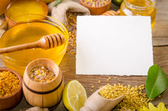Beekeeping products on a wooden table. With empty card for you text . side view stock photography