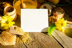 Beekeeping products on a wooden table with empty card. For you text . side view royalty free stock photos