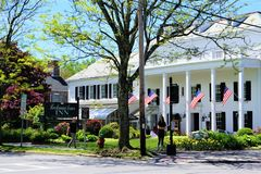 Beekman Arms Inn, Rhinebeck, New York, May 2019. The historic hotel on a sunny day with tourists walking the street in the sunshine.  Black and white façade royalty free stock photo