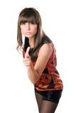 Mooie brunette die haar vinger richten stock afbeelding